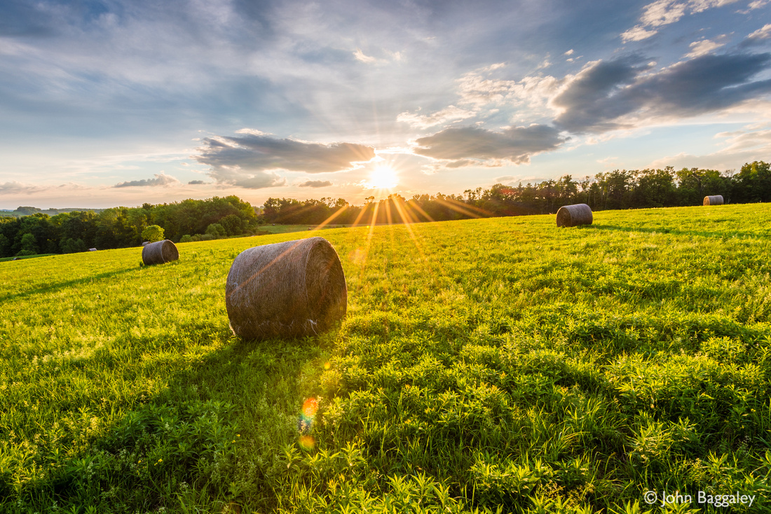 Sun rays and hay bales