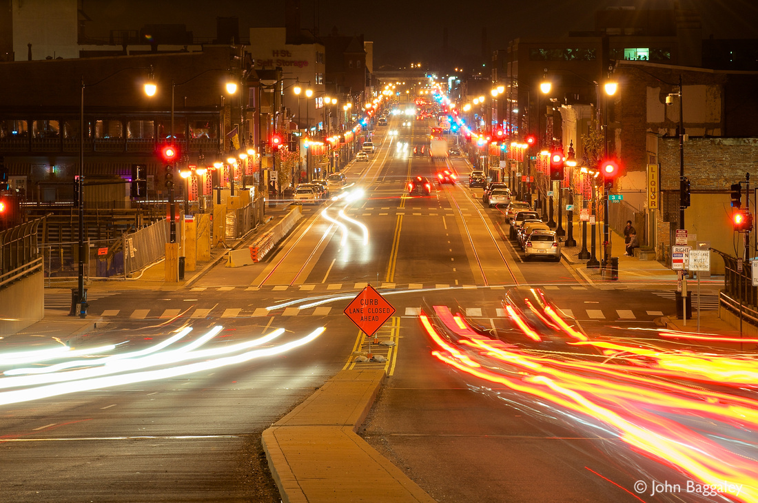 Photo by John Baggaley of traffic at night on H Street NE in Washington, DC.