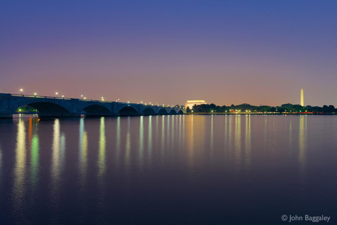 Photo by John Baggaley of Arlington Memorial Bridge and the Washington, DC, skyline at twilight.