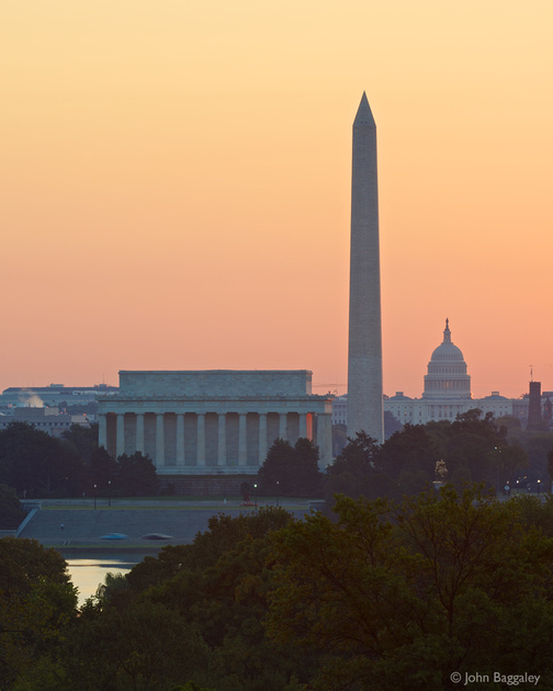 Photo by John Baggaley of the Washington, DC, skyline at sunrise. Features the the Potomac river, the Lincoln Memorial, the Washington Monument, and the Capitol.