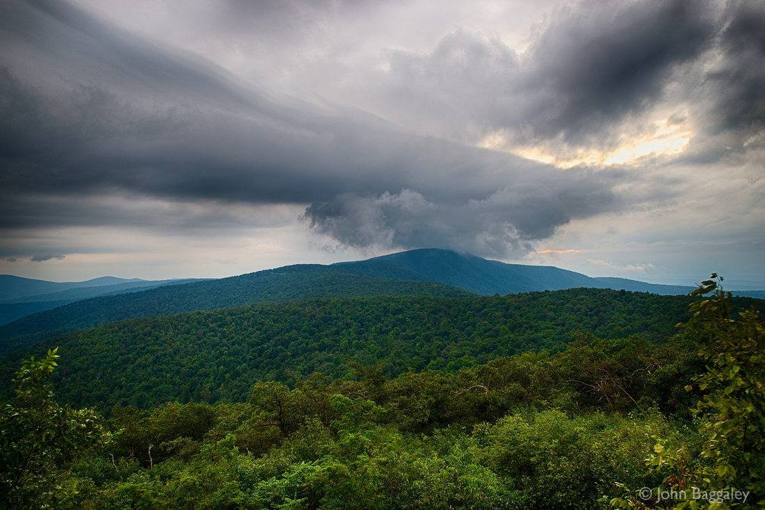 Photo by John Baggaley of dark clouds hovering over the Blue Ridge Mountains.
