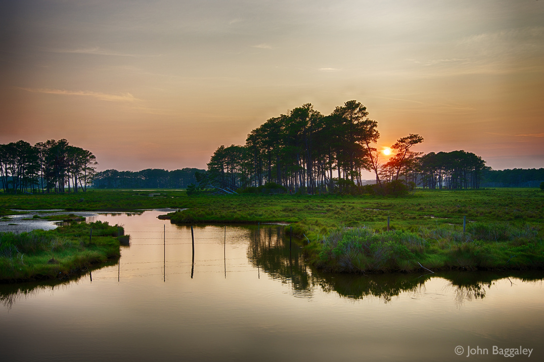 Photo by John Baggaley of a summer sunset at Chincoteague National Wildlife Refuge.