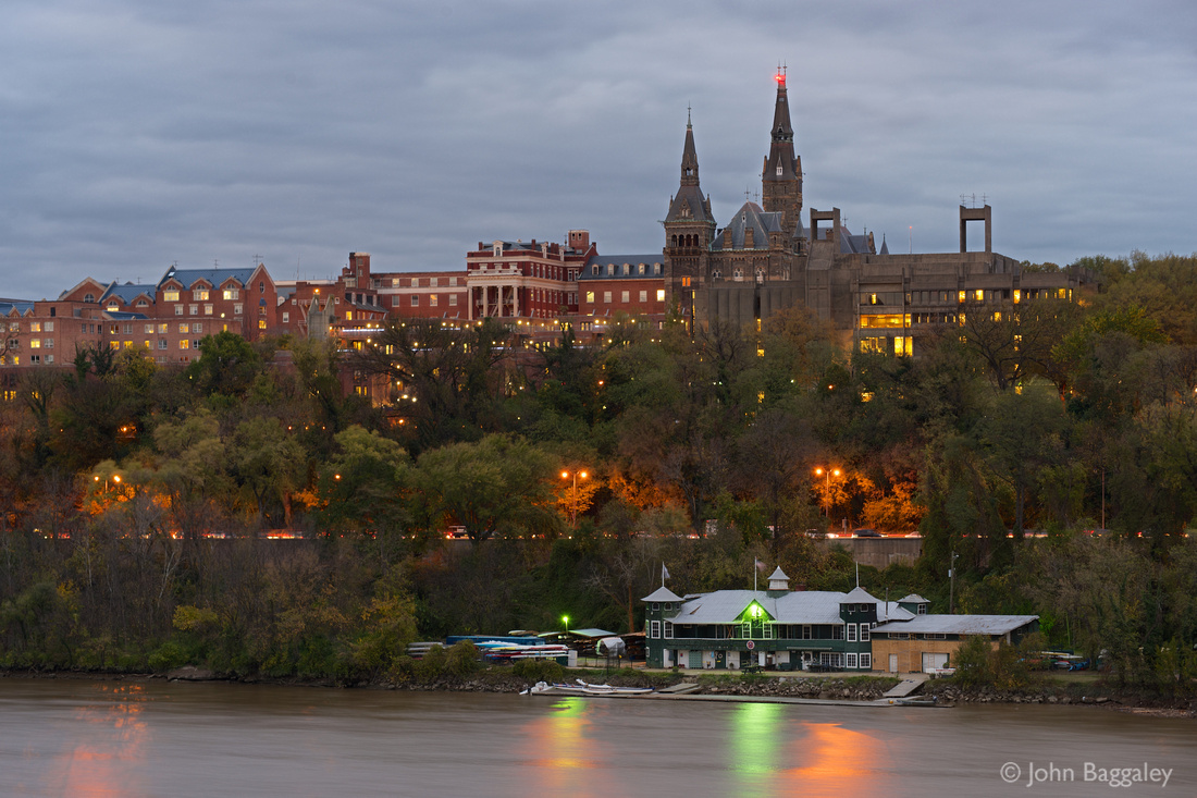 Photo by John Baggaley of the Georgetown skyline during twilight.