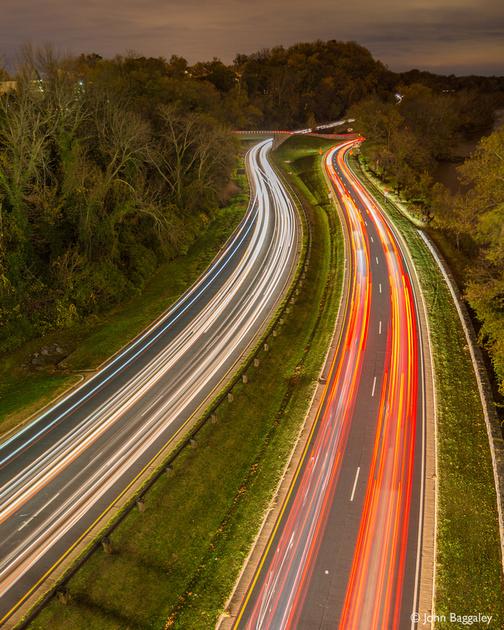 Photo by John Baggaley of rush hour traffic at night near Washington, DC.