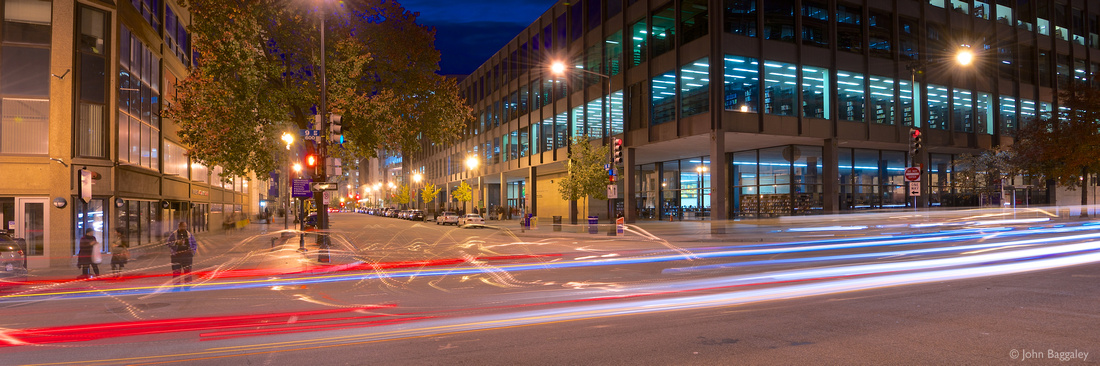 Traffic passes in front of the Martin Luther King Jr. Memorial Library in Washington, D.C., at night.