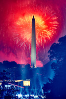 Red Fireworks and a Hazy Monument
