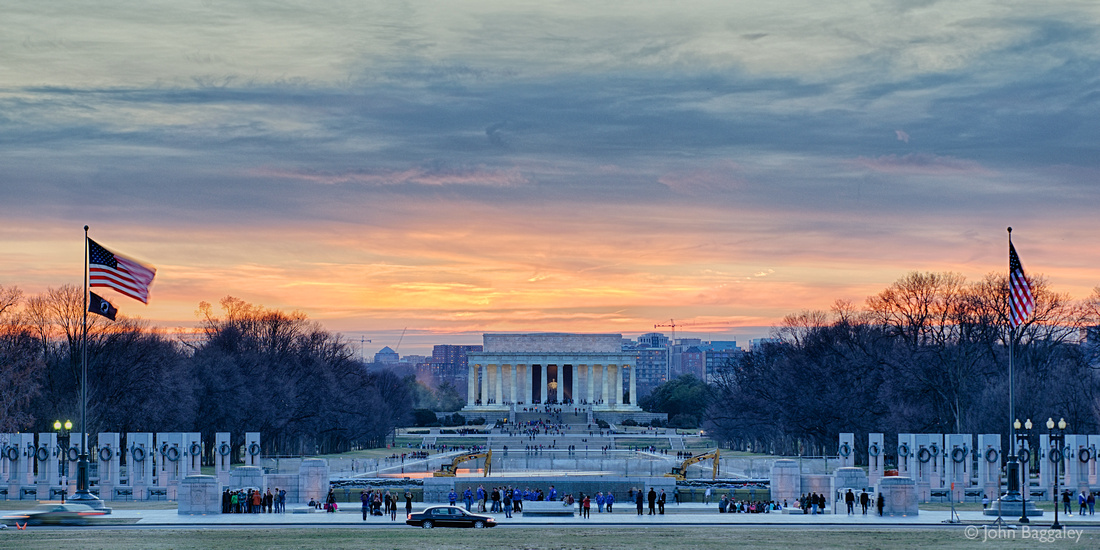 A sunset with dramatic skies over the Lincoln Memorial in Washington, DC.