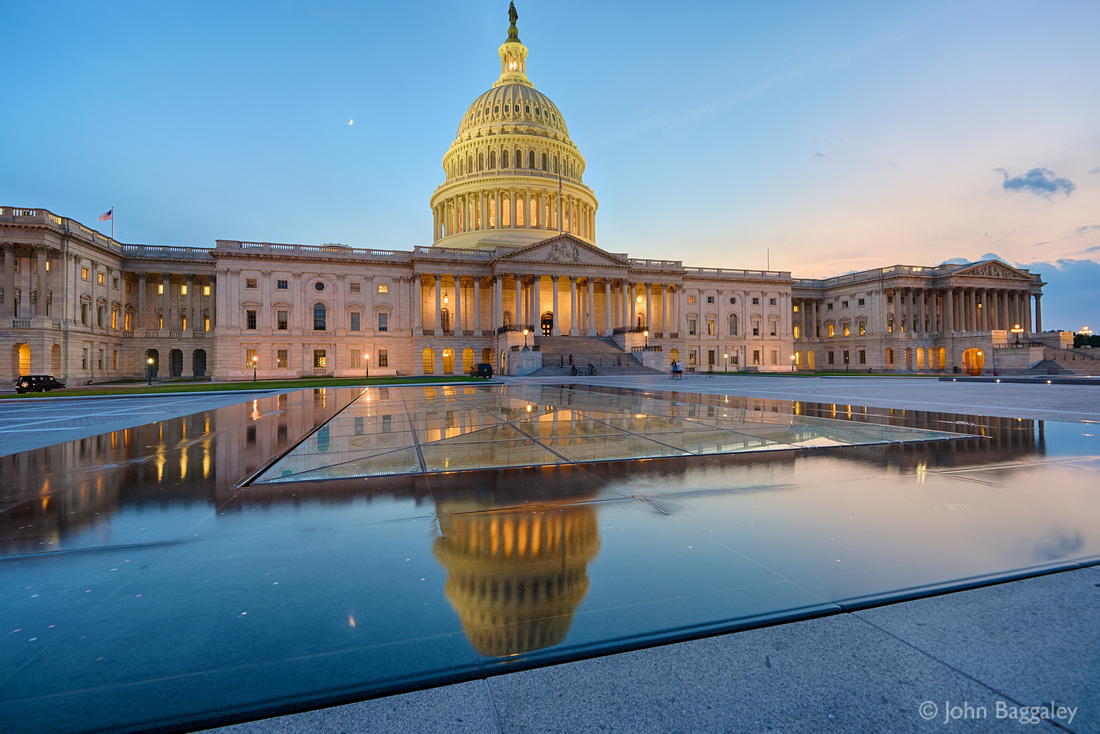 The Capitol at dusk. The dome is reflected in the skylight over the Capitol Visitor Center.