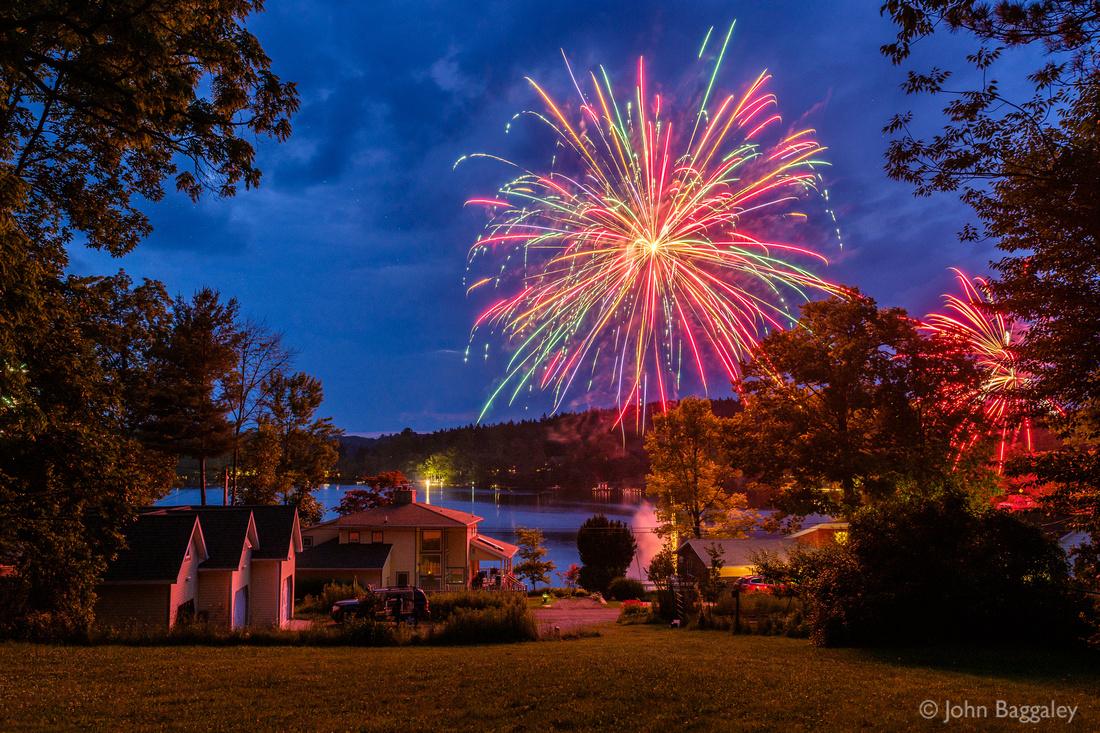 Fireworks bloom over Lake Wesauking