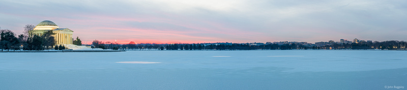 Panorama of a snowy Tidal Basin at sunset