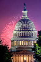 The Capitol dome with pink and purple fireworks
